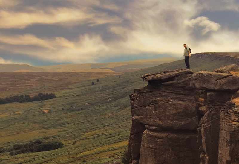 Man standing on rock at Stanage Edge where Keira Knightley stood in Pride and Prejudice