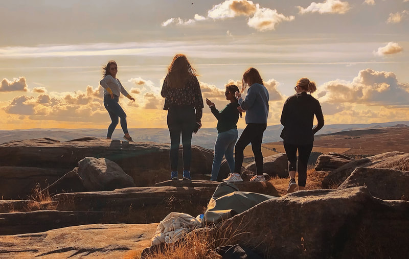 Group of girls enjoying the scenery on Stanage Edge, on a Pride and Prejudice Tour