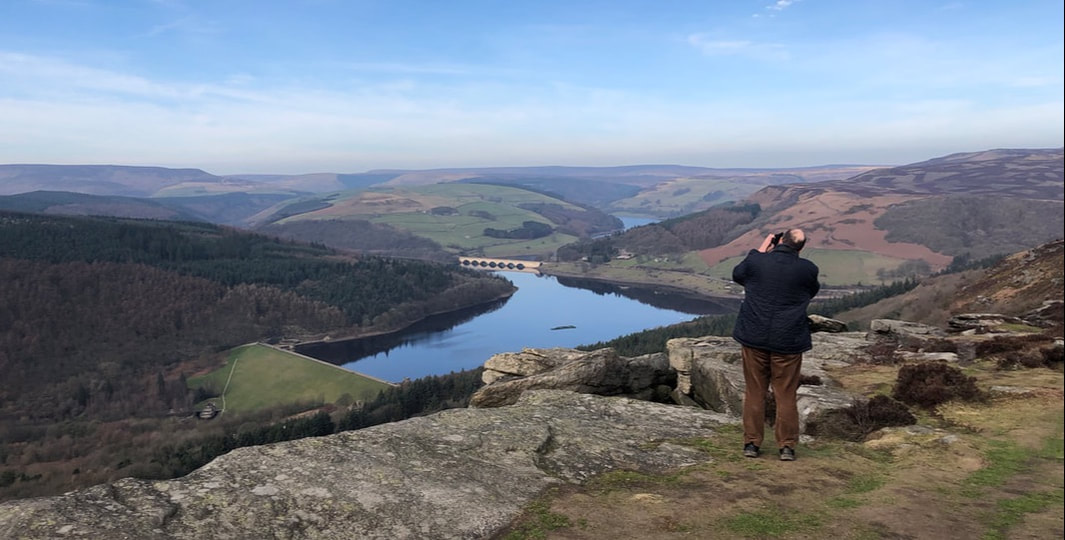 Photographer on Bamford Edge, overlooking Ladybower reservoir
