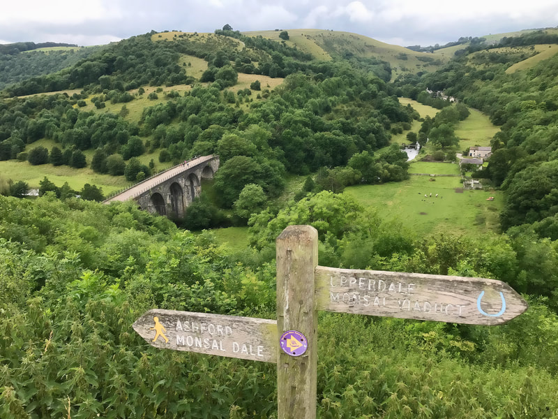 Signpost and Headstone viaduct at Monsal Dale
