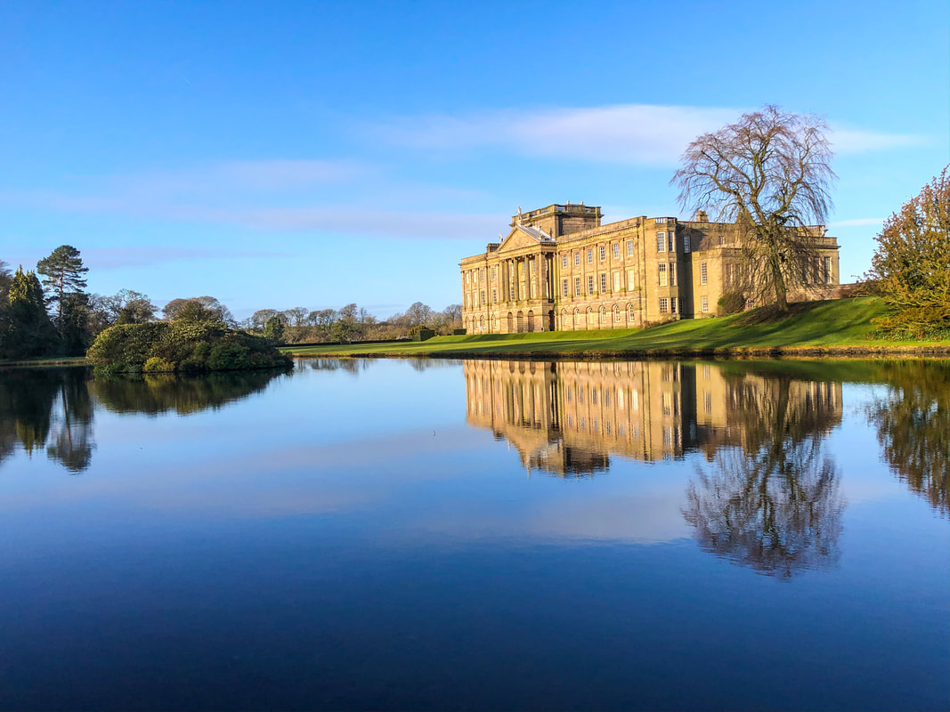 View across the lake to Lyme Hall