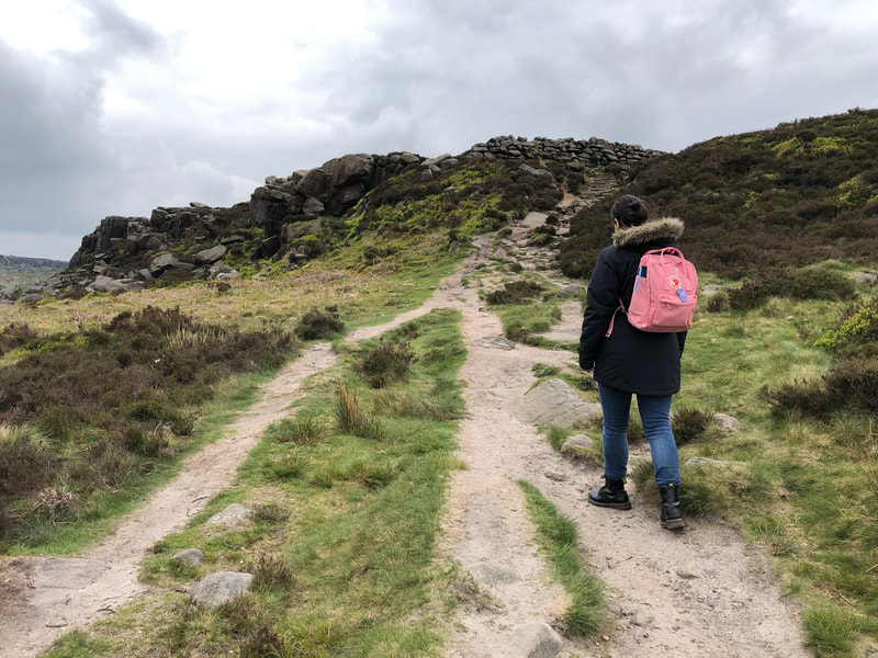 Hiking towards Carl Wark Iron Age fort in the Peak District