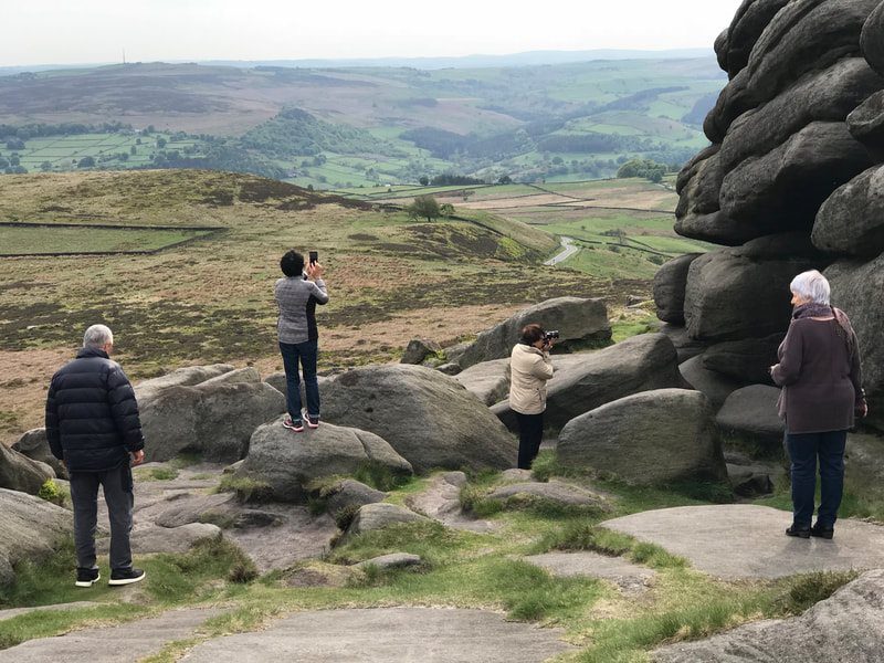 Taking photographs at Higger Tor on a Peak District scenic tour