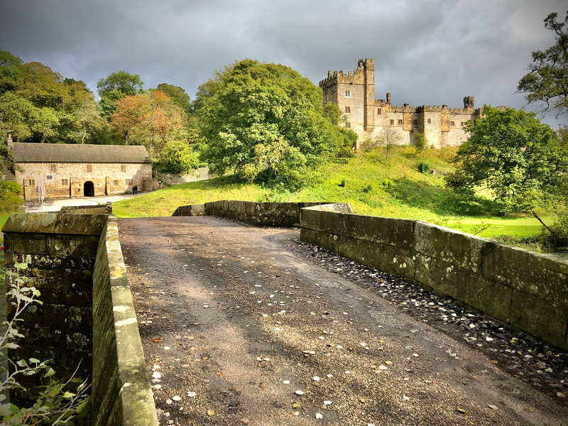 View of Haddon Hall from the bridge across the river Wye