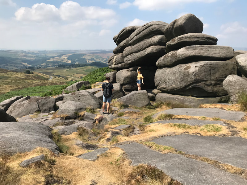 Enjoying the view from Higger Tor on a scenic tour of the Peak District