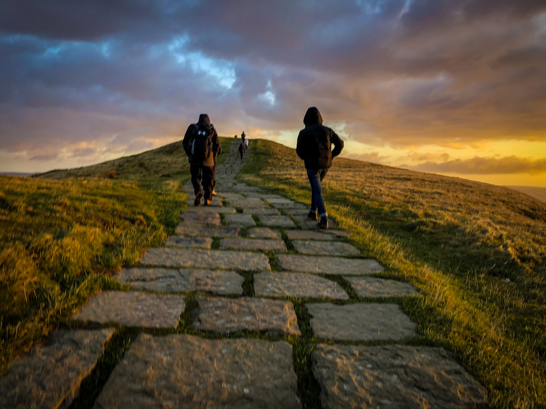Walking up Mam Tor in the Peak District at sunrise